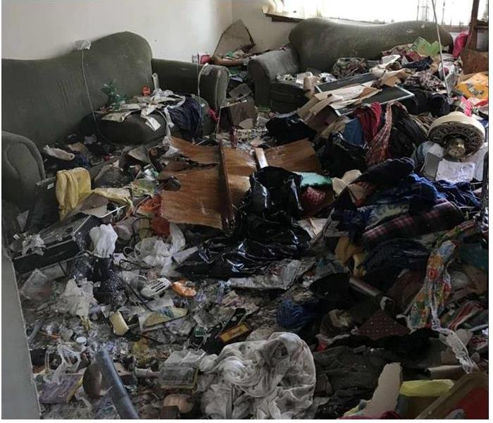 room filled with hoarding debris, no visible floor
