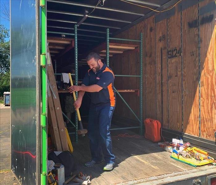 SERVPRO male employee working on the inside of a trailer