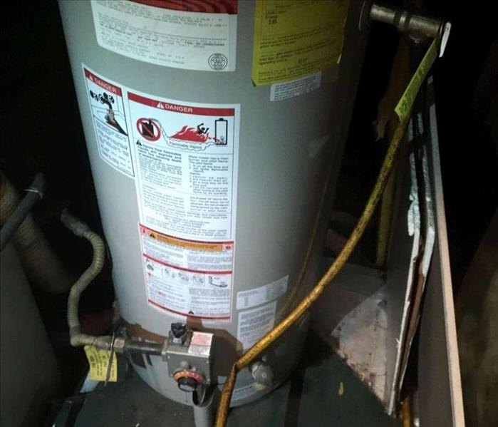 Water Damage Water damage restoration due to water heater failure